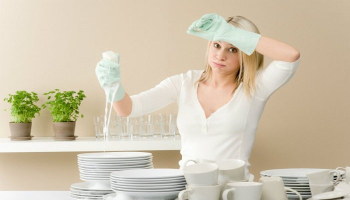 beautiful woman tired of washing dishes