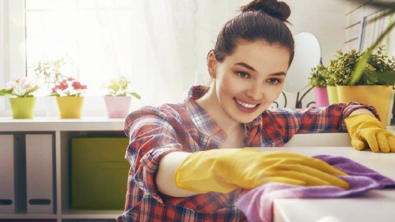 beautiful woman wiping a slab