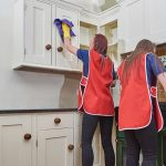 professionals sprucing up a kitchen