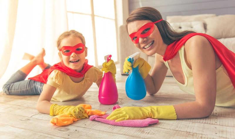a mother and a daughter wearing superman costume preparing to spruce up their house