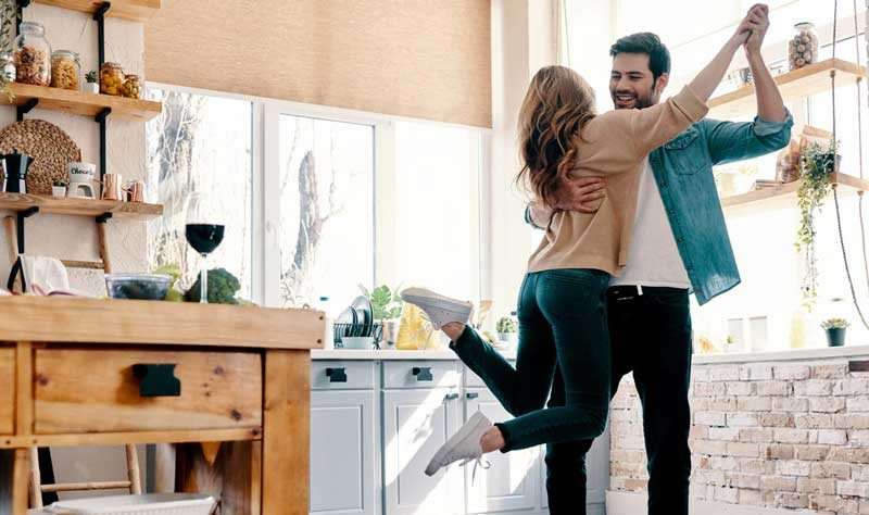 Young couple having fun inside of their house