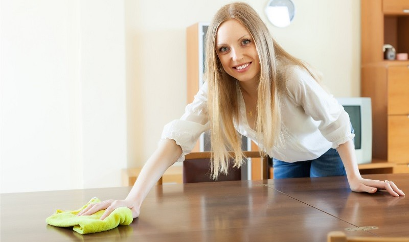 young beautiful woman wiping a surface with a cloth mop