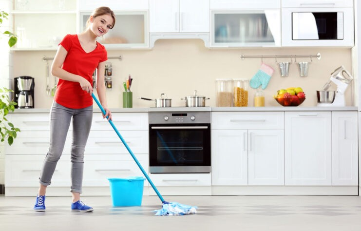 young woman sprucing up a kitchen