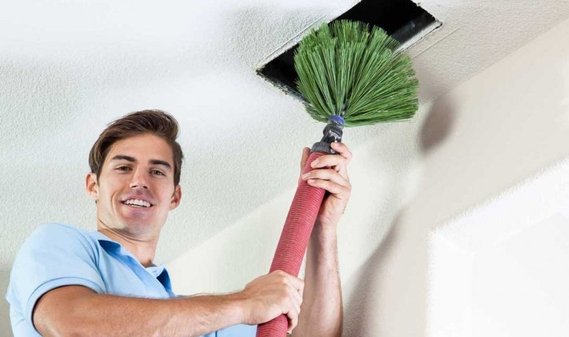 young man trying to spruce air vent